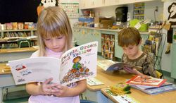 ** FILE ** Elementary school students read books in a classroom at Mount Savage School in Maryland. (Associated Press)