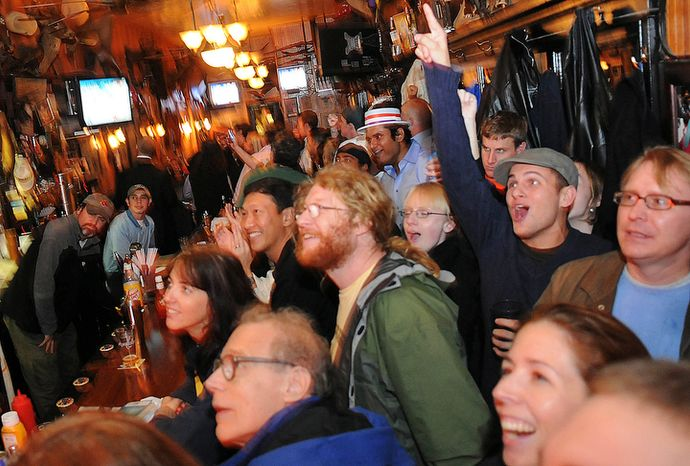 ** FILE ** Obama supporters celebrate while watching election results at the Tune Inn on Capitol Hill in Washington on Tuesday, Nov. 4, 2008. (The Washington Times)