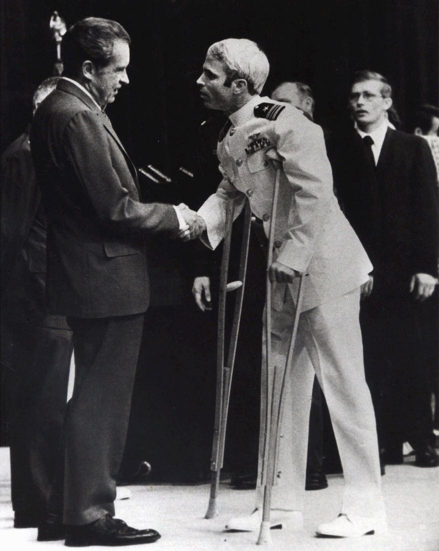 "ASSOCIATED PRESS John McCain is greeted by President Nixon in Washington in September 1973, after Mr. McCain spent more than five years in a Vietnamese prisoner-of-war camp known as the ""Hanoi Hilton."""