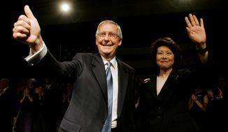 ** FILE ** In this 2008 file photo, Senate Minority Leader Mitch McConnell celebrates his re-election with his wife, Elaine L. Chao, in Louisville, Ky. (Associated Press)