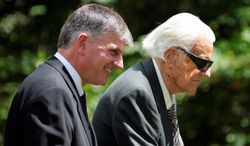 """The Rev. Franklin Graham, seen with the Rev. Billy Graham, says his 90-year-old father would """"certainly like to meet (President-elect Barack Obama) and pray with him."""" (Associated Press)"""