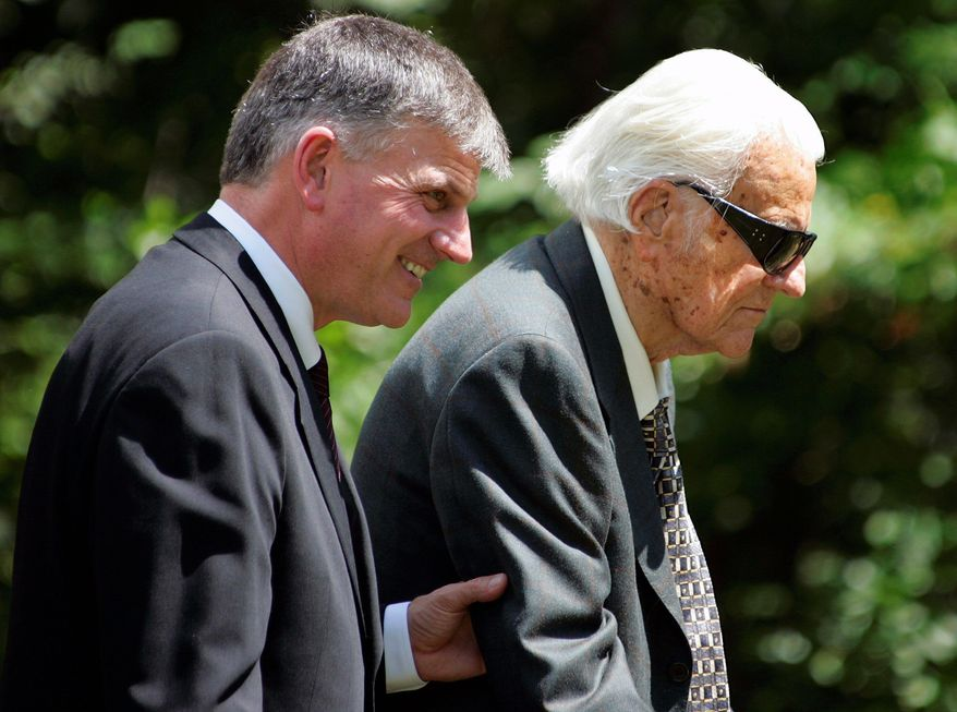 "The Rev. Franklin Graham, seen with the Rev. Billy Graham, says his 90-year-old father would ""certainly like to meet (President-elect Barack Obama) and pray with him."" (Associated Press)"