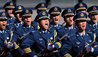 AGENCE FRANCE-PRESSE/GETTY IMAGES **FILE** Soldiers in China's People's Liberation Army march in a military ceremony in Beijing.