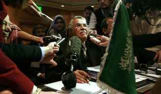 Saudi oil minister Ali al-Naimi is surrounded by journalists during the Organization of Arab Petroleum Exporting Countries (OAPEC) meeting Saturday in Cairo, Egypt. OPEC oil ministers downplayed expectations of, but didn't dismiss outright, an immediate output cut as they faced a third test in as many months of their ability to engineer a rebound in oil prices. (Associated Press)
