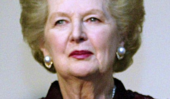 AGENCE FRANCE-PRESSE Margaret Thatcher arrives at a 2004 Conservative Party dinner celebrating the 25th anniversary of her becoming prime minister.