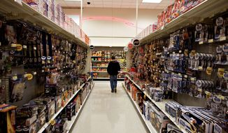 A customer browses an aisle of toys in a Super Target store. (Bloomberg News)