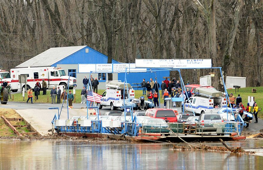 Barbara L. Salisbury/The Washington Times File People wait on the Maryland shoreline in Poolesville on as their vehicles are brought back to shore on the White's Ferry, which carries commuters between Loudoun and Montgomery counties.
