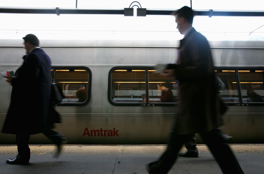 ** FILE ** Passengers board an Amtrak Acela train bound for New York at Union Station in Washington in 2008. (The Washington Times)