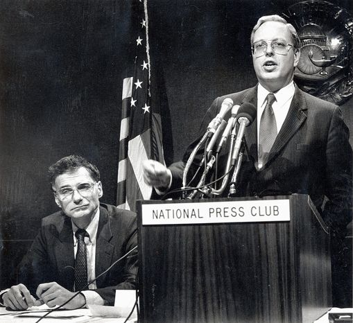 Paul M. Weyrich addresses the National Press Club in December 1988. He joined consumer advocate Ralph Nader (left) to denounce pay raises for members of Congress. Mr. Weyrich died Thursday in