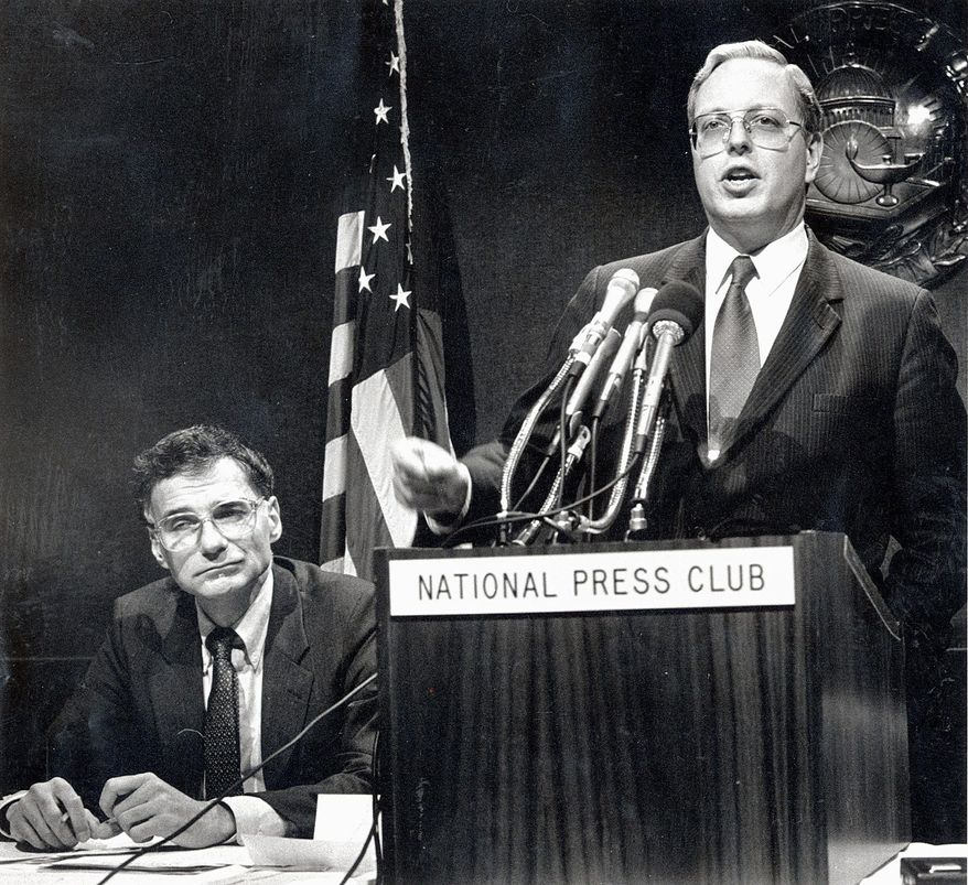 Paul M. Weyrich addresses the National Press Club in December 1988. He joined consumer advocate Ralph Nader (left) to denounce pay raises for members of Congress. Mr. Weyrich died Thursday in Fairfax after a long illness. He was 66. (The Washington Times)
