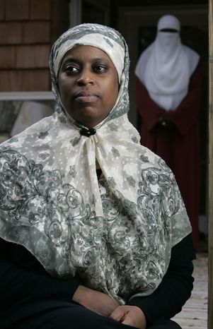 ** FILE ** Lisa Valentine is pictured at her home in Douglasville, Ga., on Dec. 17, 2008. Court and city employees in Douglasville will undergo sensitivity training and signs will be posted advising visitors of court decorum a week after police arrested a Muslim woman who refused to remove her head scarf before attending a hearing. (Associated Press)