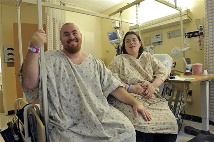 ** FILE ** Todd and Lorie Richmond speak to a reporter at the University of Chicago on Dec. 19, 2008. They both had surgery on the same day at the University Medical Center