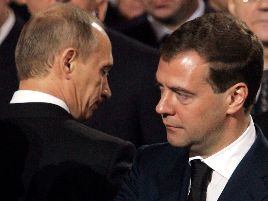 ** FILE ** Russian President Dmitry Medvedev (right) acknowledges Prime Minister Vladimir Putin during the 2008 funeral of Russian Orthodox Patriarch Alexy II at the Christ the Savior Cathedral in Moscow. (Agence France-Presse/Getty Images)