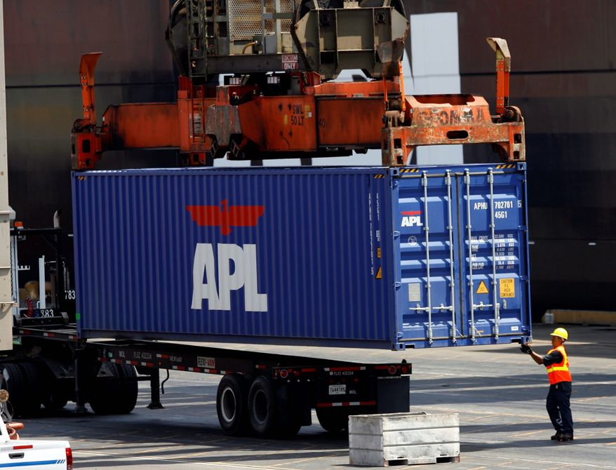 ** FILE ** A longshoreman readies a container for shipment at the APL Terminal at the Port of Los Angeles on Aug. 28, 2008. (Associated Press)
