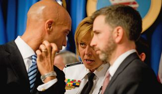 Then-D.C. Mayor Adrian M. Fenty (left), Police Chief Cathy L. Lanier and then-City Administrator Dan Tangherlini huddle during a news conference on D.C.'s preparations for Inauguration Day. (Michael Connor/The Washington Times/File) **FILE PHOTO**