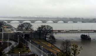 Memorial Bridge and Roosevelt Bridge, which link Virginia and the District, are among those that will be closed on Inauguration Day. Authorities are asking people to use public transportation, as drivers in the city will face restrictions, including street closures. (Barbara L. Salisbury/The Washington Times)
