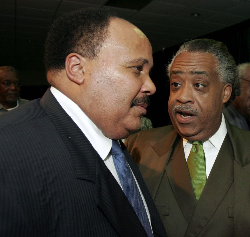 Martin Luther King III (left) and the Rev. Al Sharpton converse after their addresses to the Southern Christian Leadership Conference on Monday, July 31, 2006, in Dayton, Ohio. (AP Photo/David Kohl)