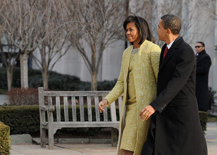 ** FILE ** Then President-elect Barack Obama and his wife, Michelle, leave St. John's Church on Tuesday morning, Jan. 20, 2009. Following the service at St. John's, the Obamas went to the White House to meet with President Bush and his wife before heading to the U.S. Capitol for the inauguration.