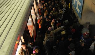 Riders crowd the L'Enfant Plaza Metro station in the early morning on Inauguration Day 2010. **FILE**