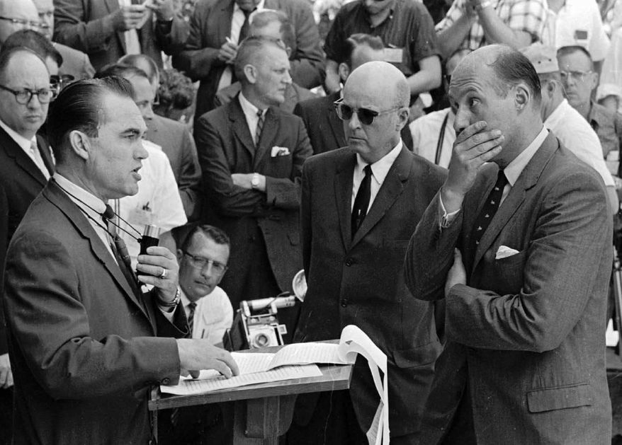 ASSOCIATED PRESS Gov. George Wallace carries out his promise to stand in the doorway to prevent integration at the University of Alabama at Tuscaloosa, Ala., on June 11, 1963. At right, Nicholas Katzenbach, deputy attorney general of the United States, listens intently to Mr. Wallace. At Mr. Katzenbach's right is U.S. Marshal Peyton Norville.
