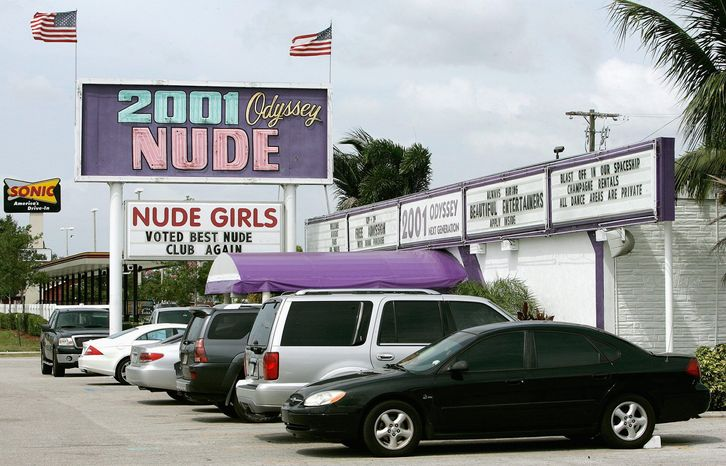 ** FILE ** 2001 Odyssey, a strip club in the Tampa, Fla., area. Citizens of Stone Park, Ill., are fighting a similar club's attempts to open next-door to a convent. (Associated Press)