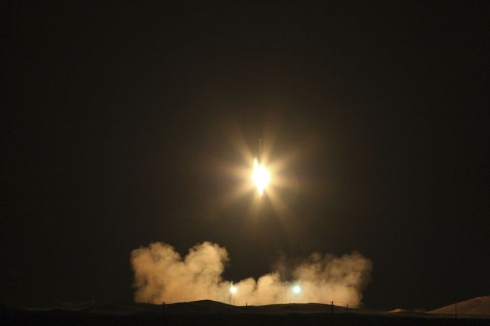 "** FILE ** This photo released by the Fars News Agency claims to show an Iranian satellite launching rocket named ""Safir-2,"" translated in English as ""Ambassador-2,"" carrying the satellite ""Omid,"" or ""Hope"" in English, photographed at launch at an undisclosed location on Monday, Feb. 2, 2009. Iran has successfully sent its first domestically made satellite into orbit, the country&"