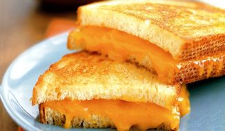 TRIBUNE MEDIA SERVICES A grilled cheese sandwich tastes great after being cooked until the undersides are golden-brown. **FILE**