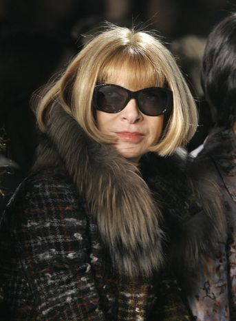 **FILE** Anna Wintour, editor-in-chief of American Vogue magazine, watches the fall 2009 collection of Thakoon during Fashion Week in New York on Feb. 16, 2009. (Associated Press)