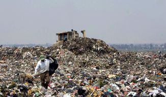 ASSOCIATED PRESS PHOTOGRAPHS A man searches for recyclable items at a garbage dump in Mexico City. The Waste Commission is working to build modern facilities to recycle, compost or burn for energy 85 percent of the city's trash - compared with 6 percent recycled today.