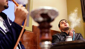 Muftis in Saudi Arabia issue a ban on smoking and tobacco use in Islam's holiest cities and sites. The ban includes the use of hookahs, which are popular in Middle Eastern culture, as seen here being smoked by Payam Rez at Lebnan Zaman in Vienna, Va. (File)