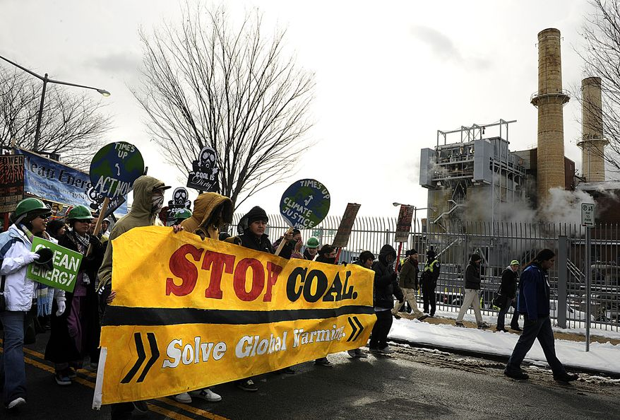 """Protesters walk past the Capitol Power Plant Monday, yelling slogans such as """"No such thing as clean coal"""" and """"Coal is dirty."""" Barbara L. Salisbury / The Washington Times"""