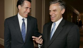 Former Massachusetts Gov. Mitt Romney (left) and former Utah Gov. Jon Huntsman