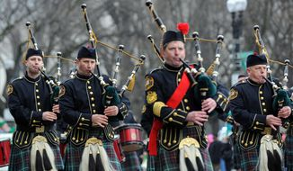 Members of Washington DC Fire Department Pipe and Drum Band participate in this year's 38th annual Washington DC St. Patrick's Day Parade which is held along Constitution Avenue.(Astrid Riecken/The Washington Times)