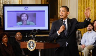 President Obama takes part in an Internet town hall meeting. (AP Photo)
