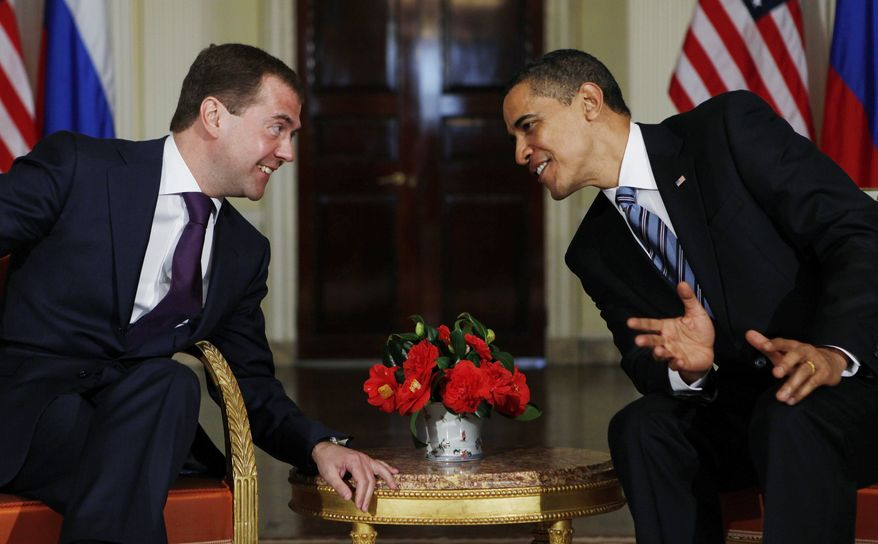 President Barack Obama meets with Russia's President Dmitry Medvedev at Winfield House in London, Wednesday, April 1, 2009. (AP Photo/Charles Dharapak)