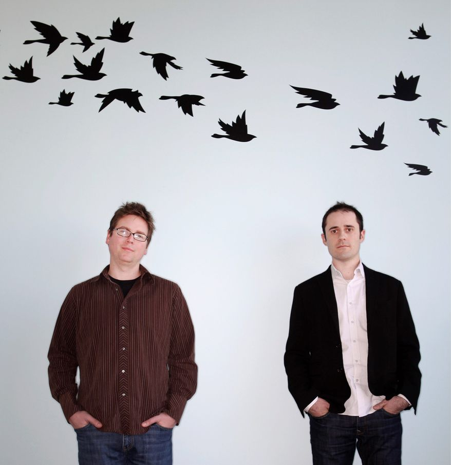 Twitter Inc. founders Biz Stone and Evan Williams (from left) are pictured at their San Francisco office. Twitter messages are limited to 140 keystrokes. Revenue has been missing so far, but the firm expects to start making money this year. (Associated Press)