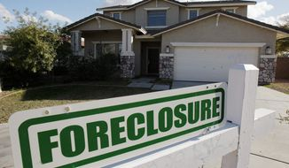 ** HOLD FOR RELEASE UNTIL 12:01 A.M. EDT THURSDAY, APRIL 16. THIS PHOTO MAY NOT BE PUBLISHED, BROADCAST OR POSTED ONLINE BEFORE 12:01 A.M. EDT THURSDAY ** FILE - In this Feb. 17, 2009 file photo, a foreclosure sign sits outside a home for sale in Phoenix. RealtyTrac releases foreclosure data for the first three months of the year on Thursday, April 16, 2009. (AP Photo/Ross D. Franklin, file)