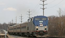 ** FILE ** This April 2, 2009, photo shows an Amtrak passenger train heading west past Western Michigan University in Kalamazoo, Mich. Amtrak and Maryland transportation officials are meeting with riders following a rash of problems with MARC train service. (AP Photo/The Gazette, Scott Harmsen)
