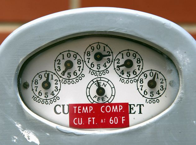 A meter's dials indicate cubic feet of natural gas consumed. Higher utility bills have left many people behind on payments, including in Maryland, where 1