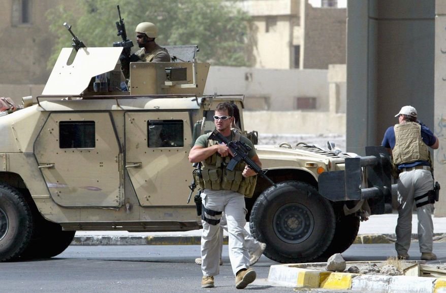 AGENCE FRANCE-PRESSE/GETTY IMAGES Contractors of the U.S. security firm Blackwater secure the site of a roadside attack near the Iranian Embassy in Baghdad in 2005. The firm, whose guards were accused of fatally shooting 17 Iraqi civilians in 2007, left Baghdad on Thursday.
