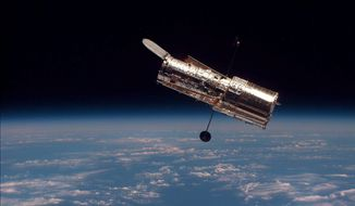 ASSOCIATED PRESS NASA scientists anticipate ideal weather conditions for the planned shuttle launch Monday to make much-needed repairs on the 19-year-old Hubble Space Telescope, seen here in February 1997.
