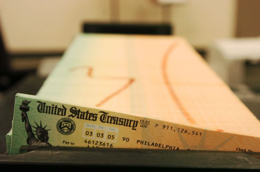 ** FILE ** Trays of printed Social Security checks wait to be mailed from the U.S. Treasury's Financial Management Services facility in Philadelphia in 2005. (Associated Press)