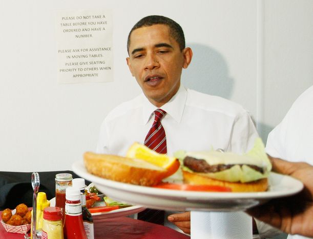 ** FILE ** President Obama is served his cheeseburger (foreground) as he and Vice President Joseph R. Biden (not pictured) eat lunch at Ray's Hell Burger in Arlington, Va., on Tuesday, May 5, 2009. (AP Photo/Charles Dharapak)