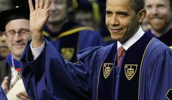 President Barack Obama acknowledges the applause of the crowd as he arrives Sunday for commencement ceremonies at the University of Notre Dame in South Bend, Ind. (Associated Press)
