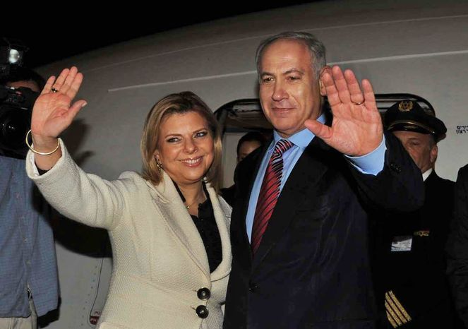 ** FILE ** In this photo released by the Israeli Government Press Office, Israeli Prime Minister Benjamin Netanyahu, right, and his wife Sara wave as they board a plane at Ben Gurion airport near Tel Aviv early Sunday, May 17, 2009, on their way for the first visit to Washington since Netanyahu became Israeli Prime Minister.
