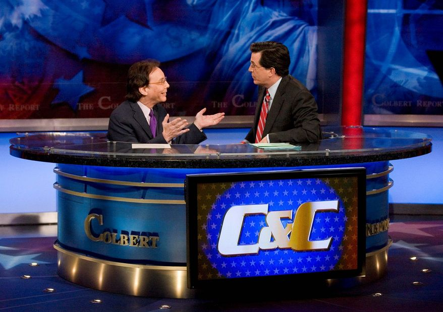 "** FILE ** Alan Colmes, left, appears with host Stephen Colbert on the set of ""The Colbert Report."" (Associated Press)"