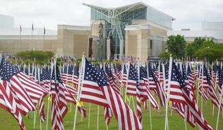 The Field of Honor near Fort Bragg's Airborne and Special Operations Museum invites people to buy and dedicate flags to service members, current and fallen. (Kelly Twedell/Special to The Washington Times)