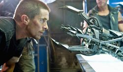 """** FILE ** Christian Bale gets a closer look at the Hydrobot Terminator in the movie """"Terminator Salvation."""" (Associated Press)"""