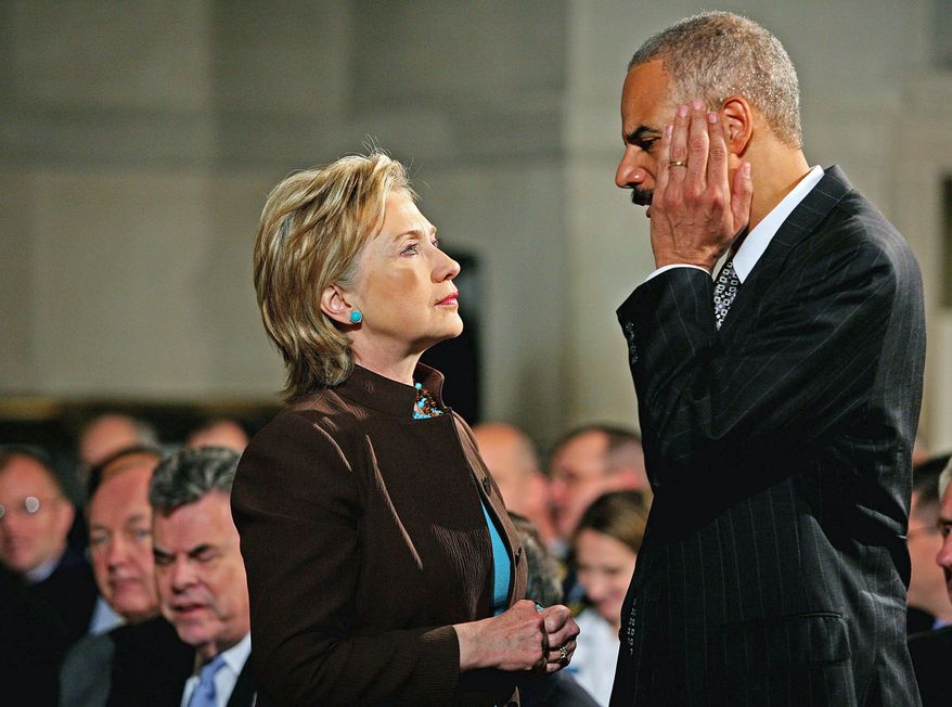Katie Falkenberg/The Washington Times Secretary of State Hillary Rodham Clinton catches up with Attorney General Eric H. Holder Jr. before Mr. Obama's 50-minute address on national security at the National Archives.