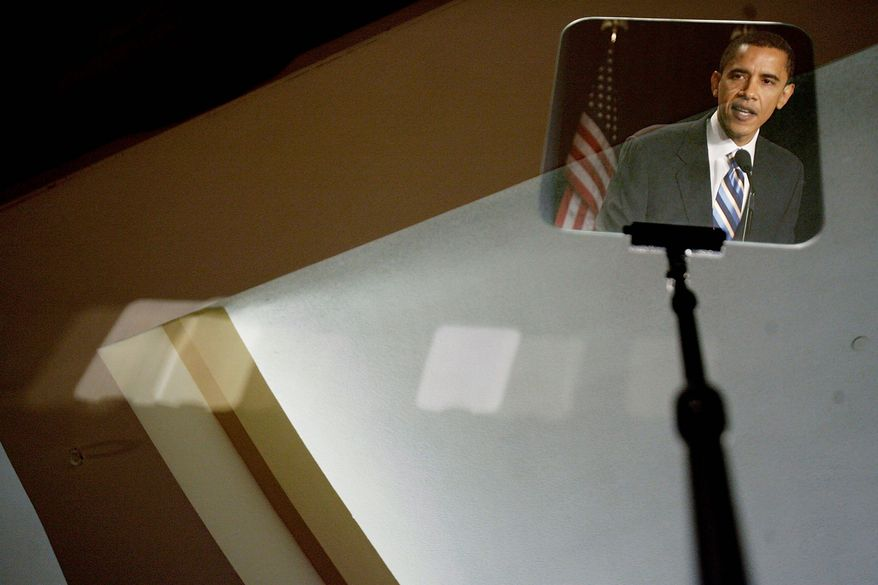 GETTY IMAGES President Obama is seen reflected in a teleprompter screen.